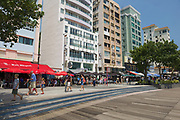 HONG KONG, CHINA - SEPTEMBER 16, 2012: Unidentified tourists walk by the street in Stanley town in Hong Kong, China. Stanley town is a tourist attraction in Hong Kong.