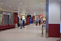 2020-03-13 | BOLOGNA, ITALIA: A almost empty airport with people wearing protective mask due to the corona virus outbreak. ( Photo by: Wilfried Butin | Swe Press Photo )<br /> <br /> Keywords: BOLOGNA, CITY, CORONA VIRUS, AIRPORT, BOLOGNA, ITALY, wbbologna140320