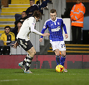 Ipswich striker Freddie Sears taking on Fulham defender Richard Stearman during the Sky Bet Championship match between Fulham and Ipswich Town at Craven Cottage, London, England on 15 December 2015. Photo by Matthew Redman.