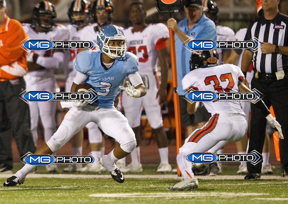 Spain Park's Derek Williams carries the ball as Hoover's Temarcus Bryant pursues him