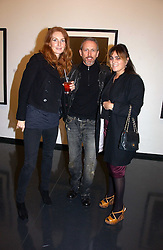 Left to right, ANGELA DUNN, PATRICK COX and SOLANGE AZAGURY at a private view of an exhibition of portrait photographs by Danish photographer Marc Hom held at the Hamiltons Gallery, 13 Carlos Place, London on 23rd October 2006.<br /><br />NON EXCLUSIVE - WORLD RIGHTS