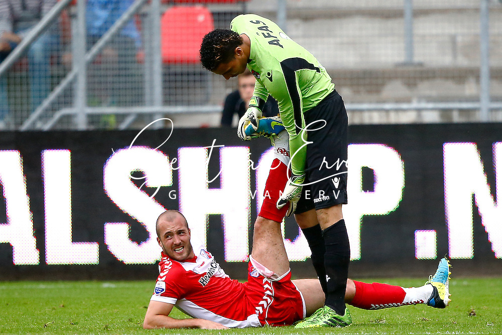 Onderwerp/Subject: FC Utrecht - AZ Alkmaar - Eredivisie<br /> Reklame:  <br /> Club/Team/Country: <br /> Seizoen/Season: 2013/2014<br /> FOTO/PHOTO: Steve DE RIDDER (L) of FC Utrecht injured and Goalkeeper Esteban ALVARADO ( Esteban Alvarado BROWN ) (R) of AZ Alkmaar checks on him. (Photo by PICS UNITED)<br /> <br /> Trefwoorden/Keywords: <br /> #03 #06 $94 &plusmn;1371811811150<br /> Photo- &amp; Copyrights &copy; PICS UNITED <br /> P.O. Box 7164 - 5605 BE  EINDHOVEN (THE NETHERLANDS) <br /> Phone +31 (0)40 296 28 00 <br /> Fax +31 (0) 40 248 47 43 <br /> http://www.pics-united.com <br /> e-mail : sales@pics-united.com (If you would like to raise any issues regarding any aspects of products / service of PICS UNITED) or <br /> e-mail : sales@pics-united.com   <br /> <br /> ATTENTIE: <br /> Publicatie ook bij aanbieding door derden is slechts toegestaan na verkregen toestemming van Pics United. <br /> VOLLEDIGE NAAMSVERMELDING IS VERPLICHT! (&copy; PICS UNITED/Naam Fotograaf, zie veld 4 van de bestandsinfo 'credits') <br /> ATTENTION:  <br /> &copy; Pics United. Reproduction/publication of this photo by any parties is only permitted after authorisation is sought and obtained from  PICS UNITED- THE NETHERLANDS
