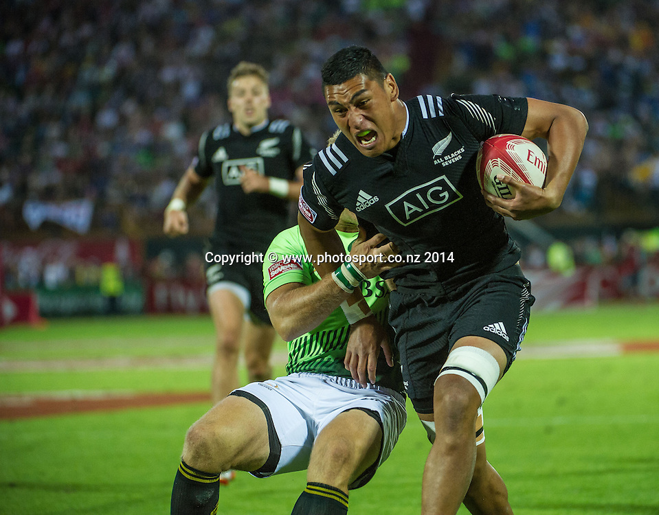 Murphy Taramai of New Zealand on the attack against South Africa during the second day of the IRB Sevens World Series rugby tournament at the Emirates Airline Dubai Rugby Sevens in Dubai, UAE, on Saturday, Dec. 6th, 2014. Photo by: Stephen Hindley/Sportdxb/Photosport