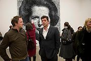 MARCUS HARVEY IN FRONT OF 'MAGGIE', White Riot, Marcus Harvey, White Cube. Hoxton Sq. London. 26 February 2009