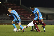 Ryan Broom, Vadaine Oliver and Rohan Ince    during the EFL Sky Bet League 2 match between Northampton Town and Cheltenham Town at the PTS Academy Stadium, Northampton, England on 29 December 2019.