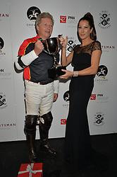 Winning captain and PRINCESS TAMARA CZARTORYSKI at the Chovgan Twilight Polo Gala in association with the PNN Group held at Ham Polo Club, Petersham Close, Richmond, Surrey on 10th September 2014.
