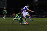 Sean Rigg of AFC Wimbledon tackles Lee Mansell (captain) of Bristol Rovers FC during the Sky Bet League 2 match between Bristol Rovers and AFC Wimbledon at the Memorial Stadium, Bristol, England on 8 March 2016. Photo by Stuart Butcher.
