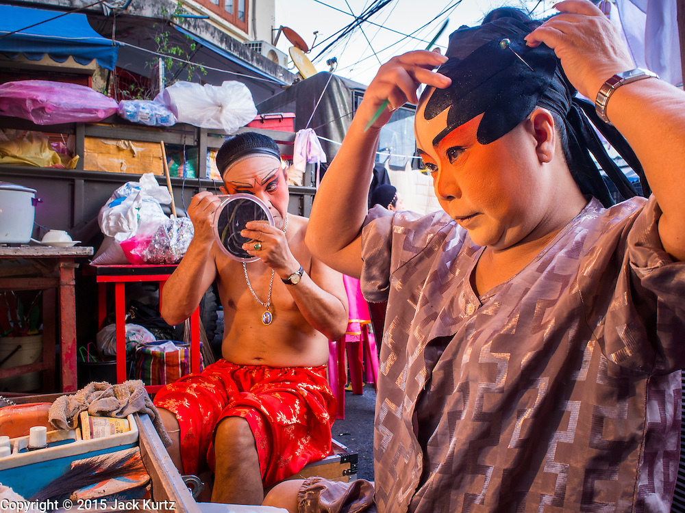 16 JANUARY 2015 - BANGKOK, THAILAND: Performers with the Sai Yong Hong Teochew Opera Troupe get into character before performing at the Chaomae Thapthim Shrine, a Chinese shrine in a working class neighborhood of Bangkok near the Chulalongkorn University campus. The troupe's nine night performance at the shrine is an annual tradition and is the start of the Lunar New Year celebrations in the neighborhood. Lunar New Year, also called Chinese New Year, is officially February 19 this year. Teochew opera is a form of Chinese opera that is popular in Thailand and Malaysia.    PHOTO BY JACK KURTZ