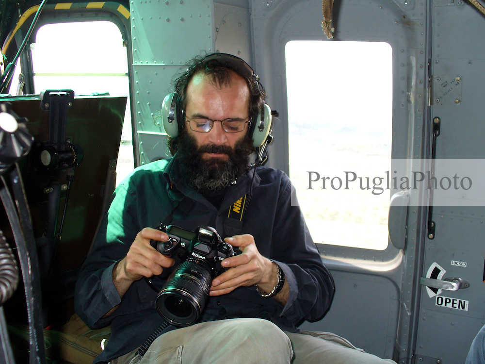 Kash on board of an helicopter while taking landscape pictures of Salento, province of Lecce