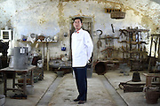 Zhou Chuanyou, Chef to the Great Hall of the People in Beijing China, poses for a portrait in the Cascina Colombara during the annual meeting of the Club des Chefs des Chefs in Livorno Ferraris, Vercelli, Italy, July 18, 2015.<br /> The Club des Chefs des Chefs, which is seen as the world's most exclusive gastronomic society, has extremely strict membership criteria: to be accepted into this highly elite club, you need to be the current personal chef of a head of state. If he or she does not have a personal chef, members can be the executive chef of the venue that hosts official State receptions. One of the society's primary purposes is to promote major culinary traditions and to protect the origins of each national cuisine. The Club des Chefs des Chefs also aims to develop friendship and cooperation between its members, who have similar responsibilities in their respective countries. <br /> The annual meeting of the Club has been hosted this year in the production site of the Italian rice company called Riso Acquerello. <br /> © Giorgio Perottino