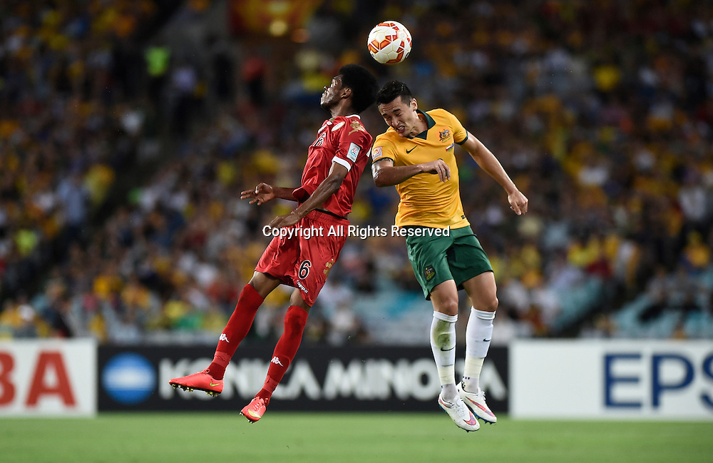 13.01.2015.  Sydney, Australia. AFC Asian Cup Group A. Australia versus Oman. Oman midfielder Raed Ibrahim Saleh and Australian defender Jason Davidson challenge for the header. Australia won the game 4-0.