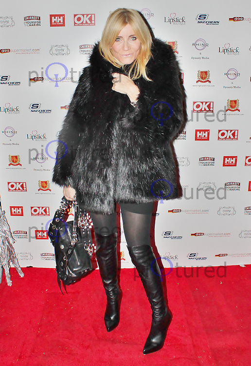 LONDON - November 27: Michelle Collins at the OK! Magazine - Christmas Party (Photo by Brett D. Cove)