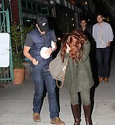 10.MAY.2011. LOS ANGELES<br /> <br /> DREW BARRYMORE LEAVING COBRAS & MATADORS RETAURANT IN LOS ANGELES AFTER HAVING DINNER WITH HER BOYFRIEND WILL KOPELMAN. THE COUPLE DRANK WINE & CUDDLED UP NEXT TO EACH OTHER FOR ALMOST TWO HOURS INSIDE. DREW WAS EXTREMELY CAMERA SHY AND COVERED UP HER FACE WITH HER RED HAIR WHILE LEAVING AND GETTING INTO THE CAR.<br /> <br /> BYLINE: EDBIMAGEARCHIVE.COM<br /> <br /> *THIS IMAGE IS STRICTLY FOR UK NEWSPAPERS AND MAGAZINES ONLY*<br /> *FOR WORLD WIDE SALES AND WEB USE PLEASE CONTACT EDBIMAGEARCHIVE - 0208 954 5968*