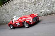 Chichester, UK - July 2013: Ferrari 166 MM Barchetta passes the flint wall in action at the Goodwood Festival of Speed on July 12, 2013.