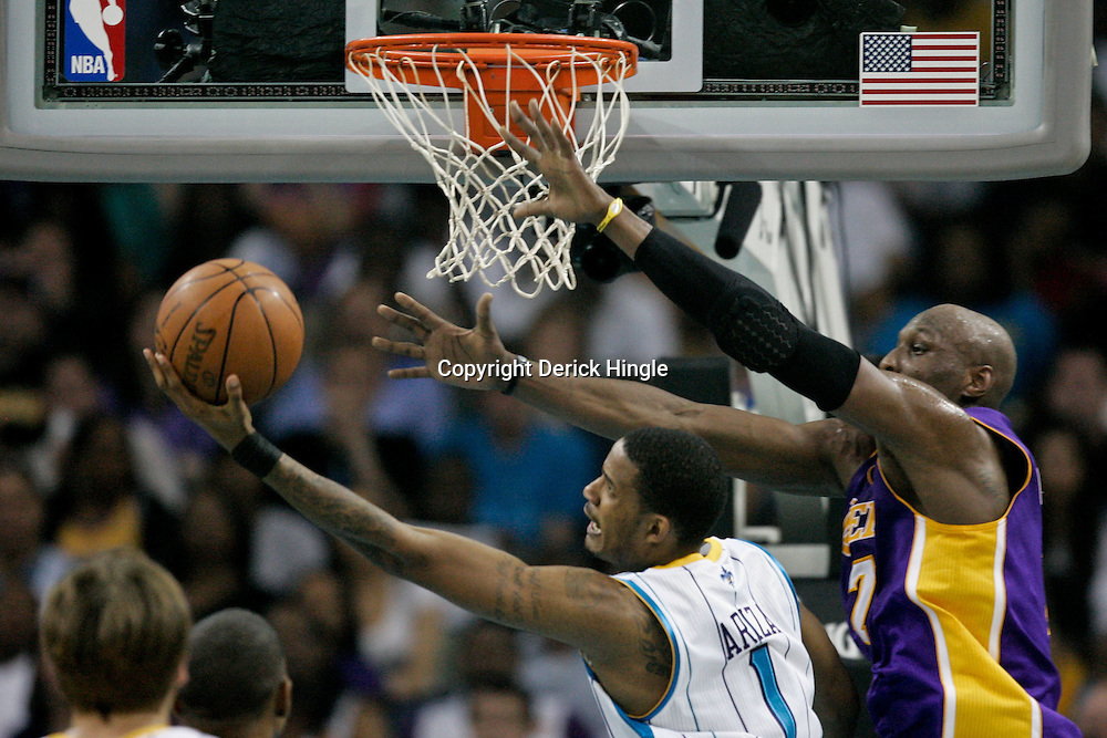 April 24, 2011; New Orleans, LA, USA; New Orleans Hornets small forward Trevor Ariza (1) shoots over Los Angeles Lakers power forward Lamar Odom (7) during the second quarter in game four of the first round of the 2011 NBA playoffs at the New Orleans Arena.    Mandatory Credit: Derick E. Hingle