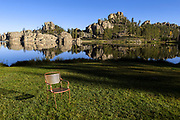 SD00066-00...SOUTH DAKOTA - Empty chair at Sylvan Lake in Custer State Park.
