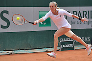 Magdalena Rybarikova from Slovakia competes in women's single round first while Day Third during Roland Garros 2014 at Roland Garros Tennis Club in Paris, France.<br /> <br /> France, Paris, May 27, 2014<br /> <br /> Picture also available in RAW (NEF) or TIFF format on special request.<br /> <br /> For editorial use only. Any commercial or promotional use requires permission.<br /> <br /> Mandatory credit:<br /> Photo by © Adam Nurkiewicz / Mediasport