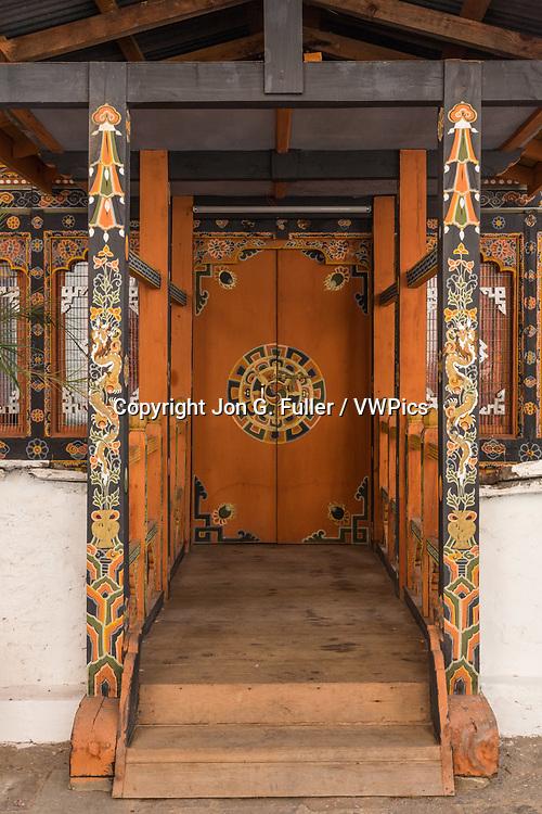 Architectural detail of Buddhist art on a door in the Punakha Dzong.  Punakha, Bhutan.