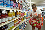Judy Elliott, of Rock Island, selects a few drinks as she shops at a Hy-Vee store in Rock Island, Illinois on Tuesday August 7, 2012.