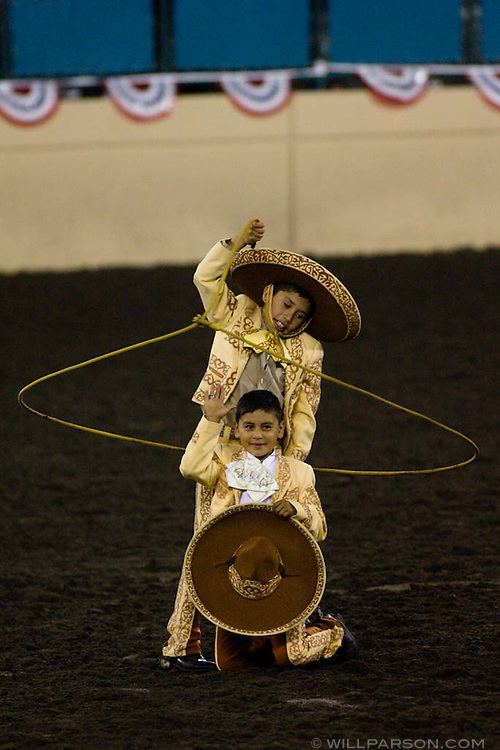 "Christian and Carlos ""Frankie"" Santoyo, ten-year-old cousins from Valley Center, perform in a routine filled with fancy horsemanship and trick roping during the PBR rodeo at the Del Mar Fairgrounds in Del Mar, California on July 26th, 2008."
