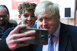 "© Licensed to London News Pictures . 15/04/2016 . Manchester , UK . A member of the audience reaches forward for a selfie with BORIS JOHNSON after he speaks at a "" Vote Leave "" rally at Old Granada Studios , in Manchester . Photo credit: Joel Goodman/LNP"