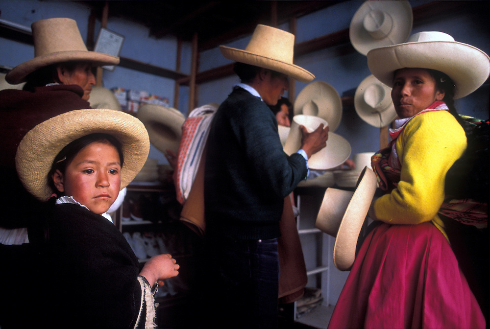 Quechua speaking Indians, descendents of the Incas, buying traditional hats which they wore at the time of the Spanish conquest, Cajamarca.