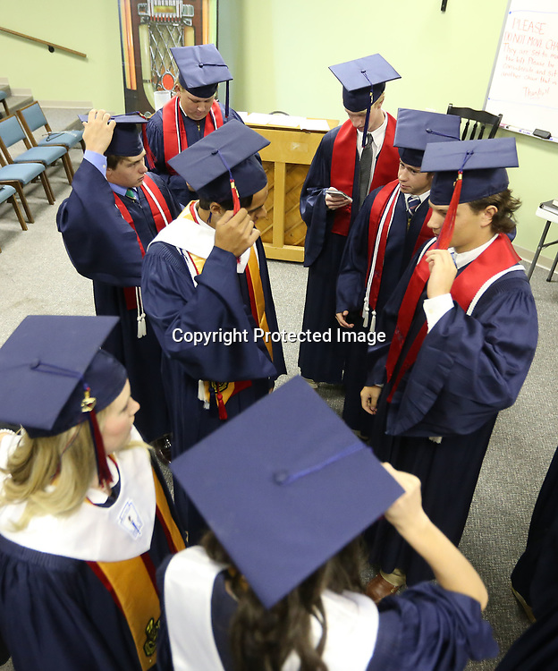 TCPS graduates hang out with in the choir room at West Jackson Street Baptist Church on Saturday before walking out to the sanctuary for their ceremony.