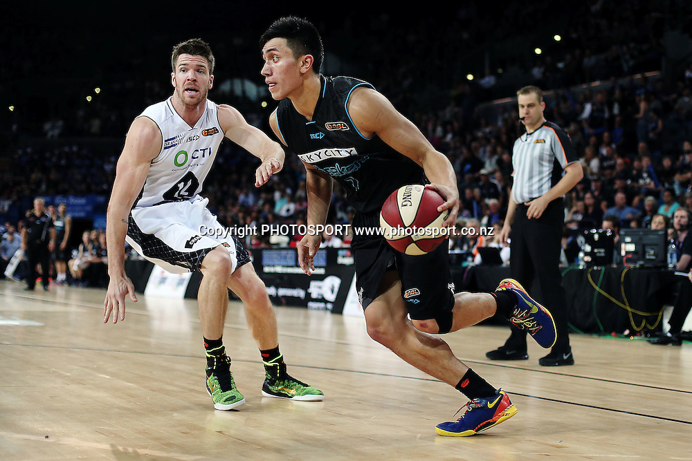 Reuben Te Rangi of the Breakers drives past Lucas Walker of Melbourne United. 2014/15 ANBL, SkyCity Breakers vs Melbourne United, Vector Arena, Auckland, New Zealand. Friday 21 November 2014. Photo: Anthony Au-Yeung / photosport.co.nz