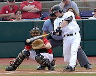 Kansas State's Joe Roundy (R) makes contact in the bottom of the fifth inning against Nebraska's Tony Watson.  Nebraska held on to be Kansas State 5-4 at Tointon Stadium in Manhattan, Kansas, April 1, 2006.