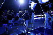 The BYU Cougars, led by guard Jimmer Fredette, center, walks on to the court as the starters are announced before an NCAA college basketball game against Utah in Provo, Utah, Saturday, Feb. 12, 2011. (AP Photo/Colin E Braley)