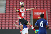Jack Stephens of Southampton U23's heads during the Under 23 Premier League 2 match between Southampton and Manchester United at St Mary's Stadium, Southampton, England on 22 August 2016. Photo by Phil Duncan.