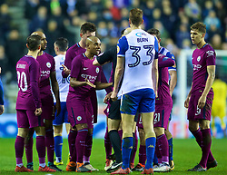WIGAN, ENGLAND - Monday, February 19, 2018: Manchester City's Fabian Delph is shown a red card and sent off by referee Anthony Taylor after a tackle on Wigan Athletic's Max Power during the FA Cup 5th Round match between Wigan Athletic FC and Manchester City FC at the DW Stadium. (Pic by David Rawcliffe/Propaganda)