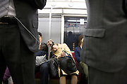 woman sleeping while commuting Japan
