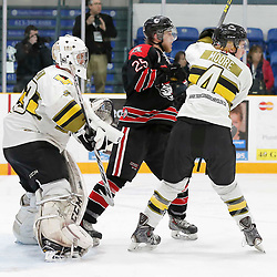 TRENTON, ON  - MAY 5,  2017: Canadian Junior Hockey League, Central Canadian Jr. &quot;A&quot; Championship. The Dudley Hewitt Cup. Game 7 between The Georgetown Raiders and The Powassan Voodoos. Jordan Anderson #25 of the Georgetown Raiders and  Cameron Moore #4 of the Powassan Voodoos battle for position <br /> (Photo by Amy Deroche / OJHL Images)