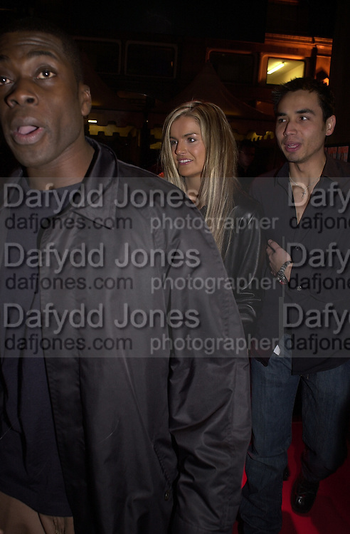 Otis, Katy Hill and Trey Farley. Glamour magazine launch party. Red Cube. 6 March 2001. © Copyright Photograph by Dafydd Jones 66 Stockwell Park Rd. London SW9 0DA Tel 020 7733 0108 www.dafjones.com