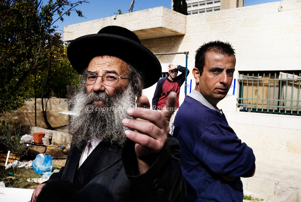 A Jewish settler is talking whit journalists in the controversial Palestinian Kurd family house in east Jerusalem's Sheikh Jarrah neighbourhood  on December 04, 2009. Israeli settlers took over the house last month and hurled the Palestinian family's belongings into the street, armed with a court order secured after a protracted legal battle with the Palestinian family. In a confidential dated December 3, the European Union accused Israel of actively pursuing the annexation of Arab east Jerusalem and undermining hopes for peace with Palestinians..© ALESSIO ROMENZI