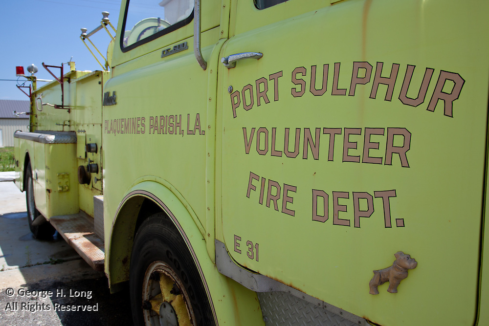 Fire trucks stored in Port Sulphur's abandoned fire station after Hurricane Katrina; Along south Louisiana's Highway 23