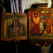 Inside the monastery of Asheton Maryam, a priest displays an ancient book depicting Jesus.