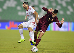Mehdi Tarem (L) of Iran vies for the ball with Wilker çngel  (R) of Venezuela during the international friendly soccer match between Iran and Venezuela at Al Ahli Stadium Doha, Capital of Qatar, November 20, 2018. The match ended with a 1-1 draw. (Credit Image: © Nikku/Xinhua via ZUMA Wire)