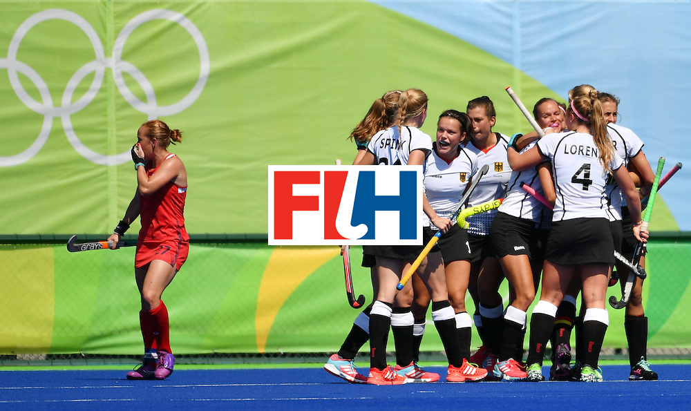 Germany's players celebrate during the women's quarterfinal field hockey USA vs Germany match of the Rio 2016 Olympics Games at the Olympic Hockey Centre in Rio de Janeiro on August 15, 2016. / AFP / Pascal GUYOT        (Photo credit should read PASCAL GUYOT/AFP/Getty Images)