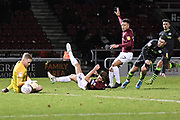Northampton Town goalkeeper David Cornell (1) makes an important save  from Forest Green Rovers forward (on loan from Celtic) Jack Aitchison (29)  shot during the EFL Sky Bet League 2 match between Northampton Town and Forest Green Rovers at the PTS Academy Stadium, Northampton, England on 14 December 2019.