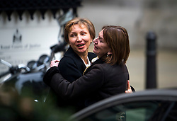 © Licensed to London News Pictures. 21/01/2016. London, UK. MARINA LITVINENKO smiling as she embraces a friend as she leaves the The High Court in London where a  report into the killing of  her husband, Alexander Litvinenko was released. Alexander Litvinenko was poisoned with the radioactive isotope polonium-210  in London. Photo credit: Ben Cawthra/LNP
