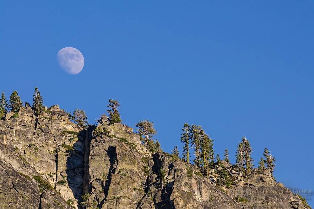 Moon over mountain ridge, Deoslation Wilderness, El Dorado County, California