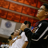 """010315       Cable Hoover<br /> <br /> Gallup High School freshman Oliver Estela sings the """"Star Spangled Banner"""" to open the Bengal's basketball game Saturday at Gallup High School."""