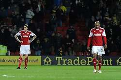 Bristol City's Aden Flint cuts a dejected figure after conceding - Photo mandatory by-line: Dougie Allward/JMP - Tel: Mobile: 07966 386802 14/01/2014 - SPORT - FOOTBALL - Vicarage Road - Watford - Watford v Bristol City - FA Cup - Third Round - replay