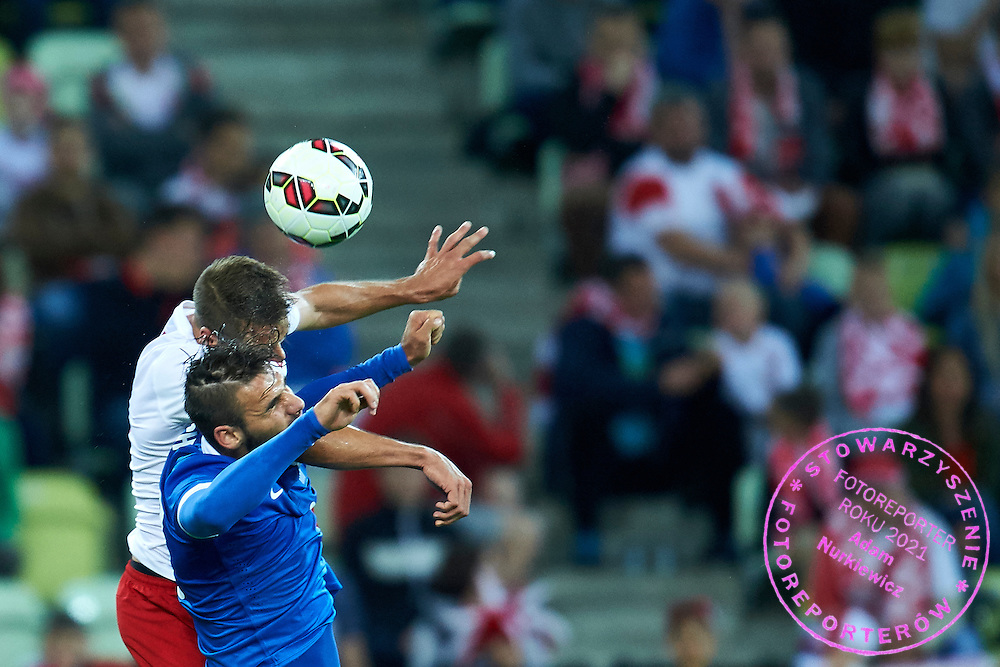 (L) Thiago Cionek from Poland fights for the ball with (R) Panagiotis Tachtsidis from Greece during international friendly soccer match between Poland and Greece at PGE Arena Stadium on June 16, 2015 in Gdansk, Poland.<br /> Poland, Gdansk, June 16, 2015<br /> <br /> Picture also available in RAW (NEF) or TIFF format on special request.<br /> <br /> For editorial use only. Any commercial or promotional use requires permission.<br /> <br /> Adam Nurkiewicz declares that he has no rights to the image of people at the photographs of his authorship.<br /> <br /> Mandatory credit:<br /> Photo by &copy; Adam Nurkiewicz / Mediasport