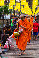 Donation to buddhist monks during the daily Binthabat morning ceremony in Sukhotai