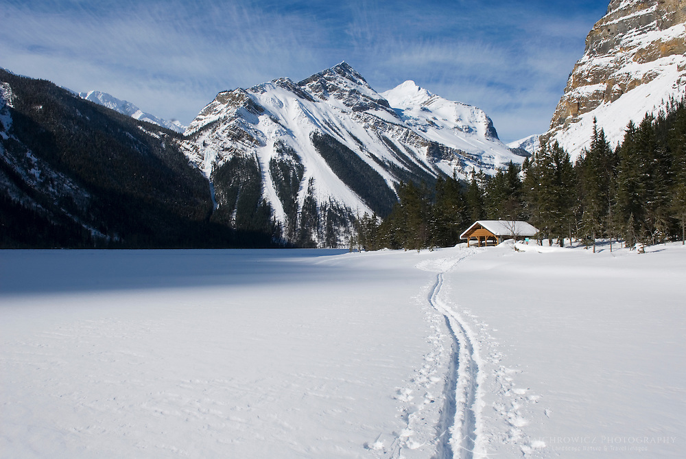 Backcountry ski track heading to warming shelter on Kinney Lake, Mount Robson Provincial Park British Columbia Canada