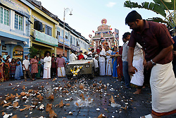 © Licensed to London News Pictures. 23/01/2016 Ipoh, Malaysia. Devotees cracks coconuts on the road for the passage of the chariot carrying the deity Lord Murugan on its way to the Kallumalai Murugan Temple in Ipoh, Malaysia, during the Thaipusam Festival, Saturday, Jan. 23, 2016. Photo credit : Sang Tan/LNP