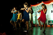 "YANGON, MYANMAR, MARCH 2012: The band on stage at the Chatrium Hotel,Yangon.<br /> Burma is a country in Transition. And if that hasn't been made clear enough by the political debates and the recent by-elections, meet the Me N Ma Girls, the first girlband in the country.<br /> The timing couldn't be better. After the April 1st elections in 2012 an always increasing number of investors from all over the world has been visiting Myanmar. After decades of military regime and isolation, the strings of censorship have started loosening up. The government censors in fact for years have banned songs and articles, deleting anything that was seen as ""to provocative"" such as leather outfits and colored wigs.<br /> Describing themselves as Myanmar's first all-girl group, under the management of the Australian dancer and choreographer Nicole May, these five women - coming from either Buddhist or Catholic background and formerly known as Tiger Girls - not only have been challenging censorship laws but they're as well trying to win hearts in a society that in many ways remains man-dominated and socially conservative.<br /> In a country that has been locked up for years, the Me N Ma Girls, embracing western pop culture with skimpy outfits and catchy songs, show with every performance the will of the Burmese youth to come out of a decades-long isolation.<br /> Five girls leading a new form of rebellion: the kind that questions roles and cultural norms."